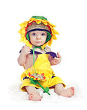 Bebé caucasiano em um vestido extravagante do girassol Fotografia de Stock Royalty Free
