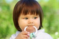 Bebê com chocalho Fotos de Stock