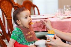 Bebê com fome Imagens de Stock