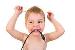 Bebê com plugue Imagens de Stock