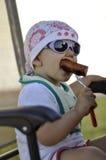 Bebê com salsicha grelhada Fotos de Stock Royalty Free