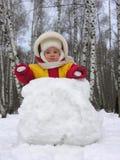 Bebê com snowball Fotos de Stock Royalty Free