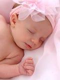 Bebé con el arqueamiento rosado Imagen de archivo