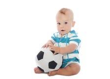 Bebé con el balón de fútbol Fotos de archivo