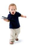 Bebé con el teléfono Foto de archivo libre de regalías