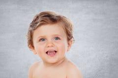 Bebé con un años que hacen gestos divertidos Fotos de archivo libres de regalías