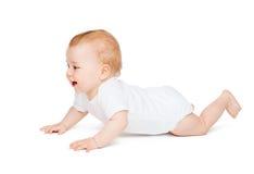 Bebê curioso de rastejamento que olha acima Fotos de Stock Royalty Free