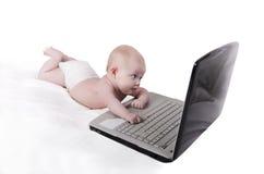 Bebé de la computadora portátil Fotos de archivo libres de regalías