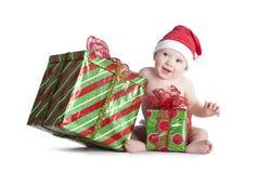 Bebé del regalo de Navidad Fotos de archivo