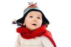Bebé descontentado que desgasta la ropa caliente del invierno Imagen de archivo libre de regalías