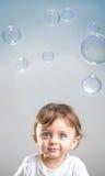 Bebê e bolhas Fotos de Stock Royalty Free
