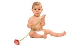 Bebê e flor Fotografia de Stock