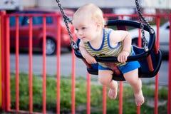 Bebê em um balanço Foto de Stock Royalty Free