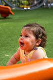 Bebê em um campo de jogos Fotos de Stock