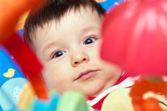 Bebé en juguetes Foto de archivo