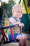 Bebé en un oscilación Fotografía de archivo
