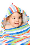 Bebé feliz en colores Foto de archivo