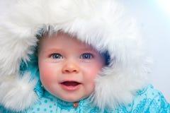 Bebé feliz en nieve Fotografía de archivo