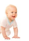 Bebé feliz que mira hacia fuera y que sonríe. Fotos de archivo libres de regalías