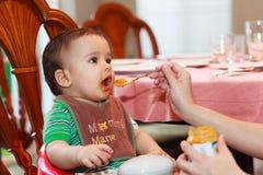 Bebé hambriento Imagenes de archivo