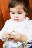 Bebé lindo con el libro Imagen de archivo