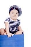 Bebê pequeno bonito no jogo da forma do marinheiro Foto de Stock Royalty Free