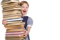 Bebê pequeno com os livros isolados Foto de Stock