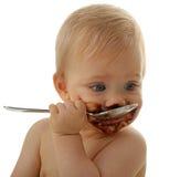 Bebé que come el chocolate Fotografía de archivo libre de regalías