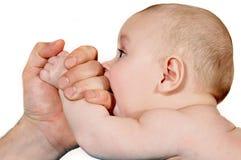 Bebé que lucha Foto de archivo