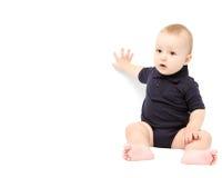 Bebé que muestra en el fondo blanco Imagenes de archivo