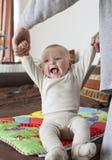 Bebé que se incorpora Imagen de archivo