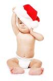 Bebé-Santa con el sombrero rojo de la Navidad Foto de archivo