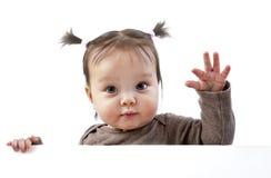 Bebé sobre la mano que agita de la bandera Imagen de archivo libre de regalías
