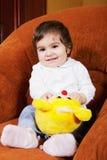 Bebé sonriente con el juguete Imagen de archivo