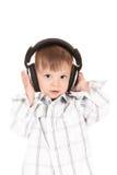 Bebé sonriente con los auriculares Imagen de archivo
