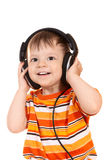 Bebé sonriente con los auriculares Fotos de archivo libres de regalías
