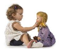 Bebé y muñeca Imágenes de archivo libres de regalías