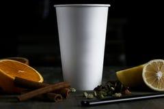 Beba em um copo branco em uma tabela de madeira Fotografia de Stock
