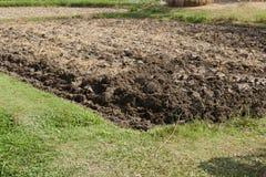 Bebauter Boden im Ackerland Stockbilder