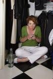 Bebedor avergonzado del armario Imagen de archivo libre de regalías
