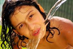 Beber da mangueira Imagens de Stock Royalty Free