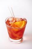 Bebida alaranjada do cocktail com limão e cereja Imagem de Stock Royalty Free