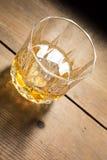 Bebida alcoólica na tabela de madeira Fotografia de Stock Royalty Free