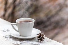Bebida caliente en la taza Fotografía de archivo