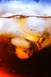 Bebida com cubo de gelo imagem de stock