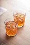 Bebida fría anaranjada del cóctel del verano Imagenes de archivo