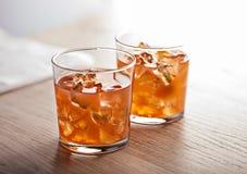 Bebida fría anaranjada del cóctel del verano Foto de archivo
