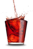 Bebida vertida en el vidrio Imagen de archivo libre de regalías
