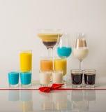 Bebidas coloridas basadas en los licores de la leche, colores en colores pastel únicos de Imagen de archivo libre de regalías