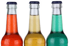 Bebidas coloridas da soda em umas garrafas isoladas Fotografia de Stock Royalty Free